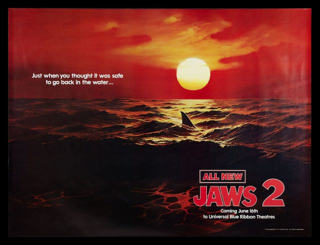We think this very cool painting-masquerading-as-photo Advance Preview Poster for Jaws 2 deserves a shout-out.